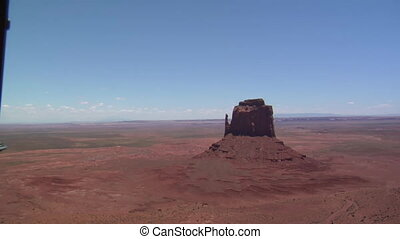 aerial shot of Monument Valley mittens with helicopter door