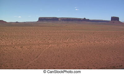 red rock desert with distant buttes