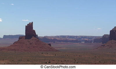 aerial shot of Monument Valley buttes zoom out
