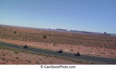 aerial shot of three motorcycles on Monument Valley Highway