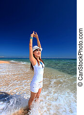 Woman doing stretching on beach - Young woman doing...