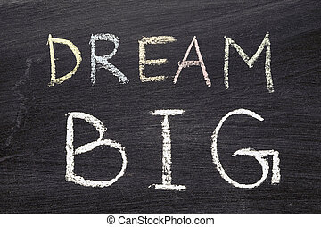 dream BIG phrase handwritten on school blackboard