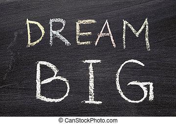 dream BIG phrase handwritten on school blackboard