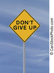 Don't Give Up road sign (against a blue sky background)