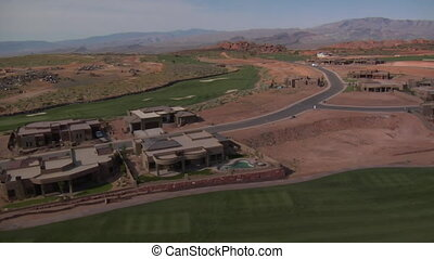 Aerial shot of Mansions on desert golf course