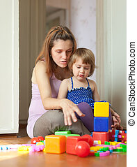 pregnant mother plays with child - Happy pregnant mother...