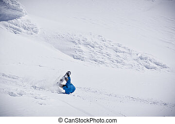 Snowboarder Falling - A snowboarder is in snowy backcountry...
