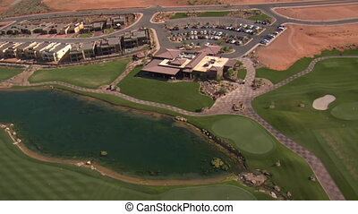 Aerial shot of clubhouse on desert course with lake