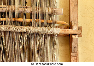 An ancient hand loom used to weave cloth and blankets