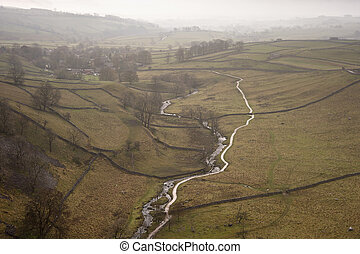 Misty morning view along Malham Beck and Dale in Yorkshire Dales National Park