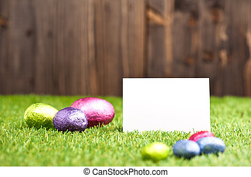 Chocolate Easter eggs in an outdoor setting with place card