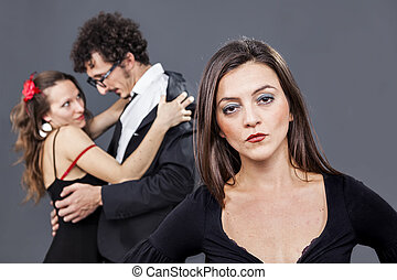 betrayal behind her shoulders - girl is sadly looking while...