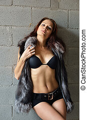 Sexy woman in the fur vest