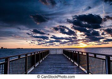 Backlit buffalo pier at sunset - Photograph of a backlit...