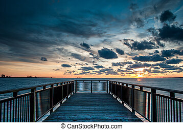 Backlit Pier at sunset - Photograph of a backlit pier...