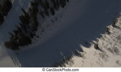 aerial shot of skiers rotating 360