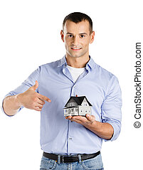 Real estate agent hands model house