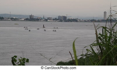 grasses rack focus to boats on the Congo River