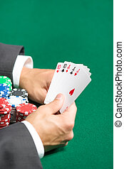 Male player with full house on hands