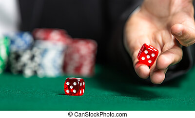 Player rolls dices on the green table - Player throws dices...