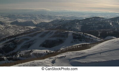 aerial shot of ski resort, mountains, and town