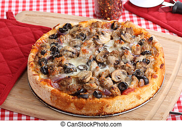 Whole Deep Dish Pizza - Deep dish pizza topped with sausage,...
