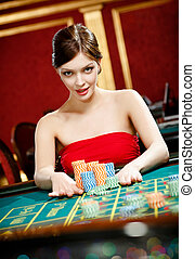 Woman placing a bet at the gambling house