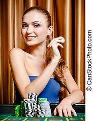 Female gambler at the playing table - Portrait of the female...