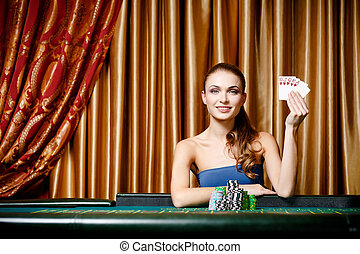 Female gambler at the poker table - Portrait of the female...