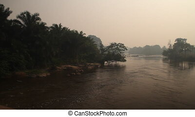 jungle River with haze and fishermen