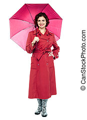 Fashionable young woman in maroon overcoat