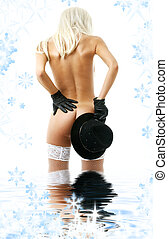 hat games in water - blonde girl with black hat standing in...