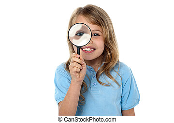 Smiling kid with magnifying glass - Fun loving girl child...