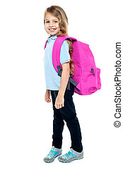 Happy little girl carrying school bag - Attractive child...