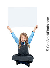 Sweet kid holding blank ad board above her head - Cheerful...