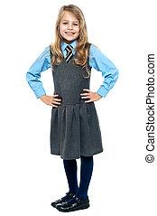 Pretty school girl posing confidently - Charming kid posing...