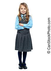 Confident school girl in pinafore uniform - School girl...