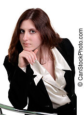 Beautiful young woman posing in business suit