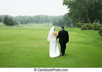 Wedding couple - wedding couple walking at a golf course