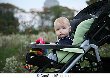Baby in Stroller - Baby sitting in a stroller outside