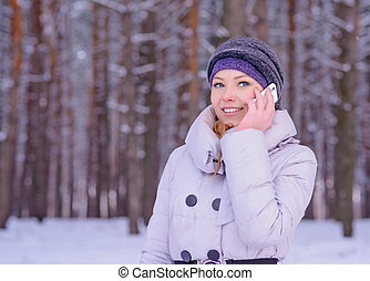Beautiful Young Woman Talking on the Phone Outdoor