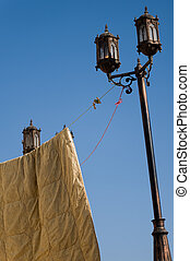 Streetlight with clothes hanging