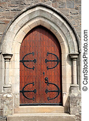 Ancient Doorway - Old wooden oak arched gothic church...
