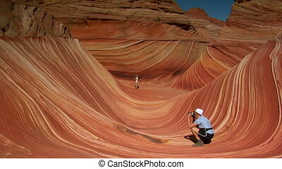 people taking pictures in the wave a of northern Arizona