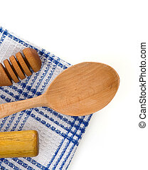 wood utensils at table napkins isolated on white background