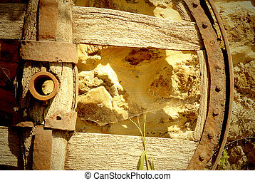 old cart wheel in a stone wall