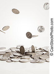 Falling Coins - A group of silver coins are falling down...