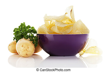 potato chips in a purple bowl with potatoes and parsley...