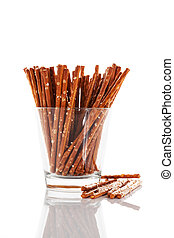 pretzel sticks in a glass on white background