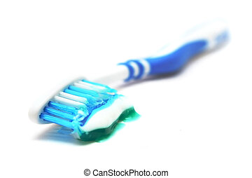 Toothpaste On Brush - Tooth brush with toothpaste on white...